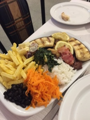 Everything I could possibly need for dinner - Rice, meat, spinach, beans, chips, ham, carrots and banana